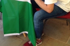 Sonny writing out a vine leaf at Italian Festival - Grapevine project 15  - Version 2